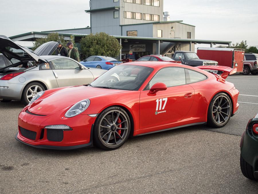 Red Porsche 911 Turbo, front three quarter view.